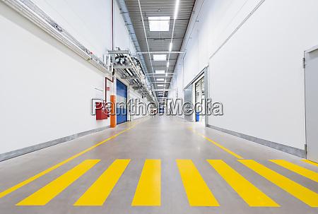 long corridor in empty factory