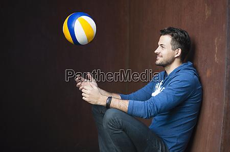 smiling man throwing ball