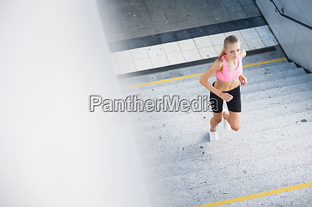 female jogger on stairs
