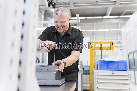 smiling, man, working, at, workbench, in - 28745482