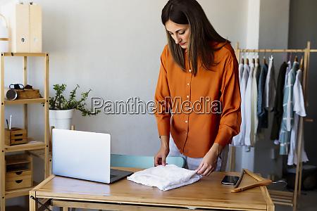 female fashion designer working at home