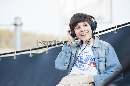 cheerful boy looking away while listening