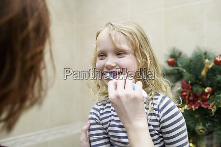 cropped image of woman assisting daughter