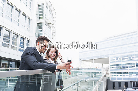 business couple using smart phone on