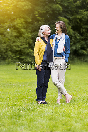 happy senior woman and adult daughter
