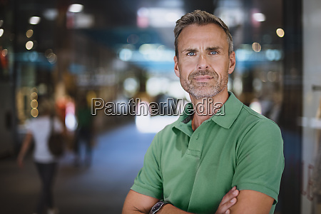 confident mature man with arms crossed