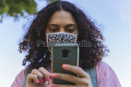 mature woman using smart phone during