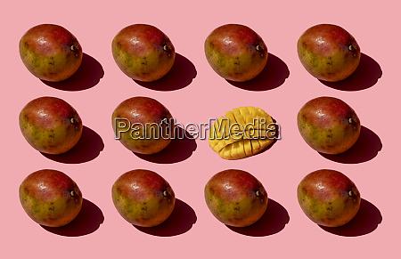 whole and one chopped mango pattern