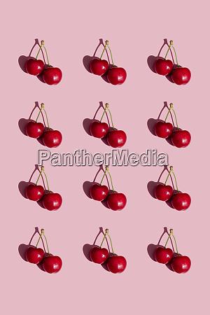 pattern of fresh cherries on pink