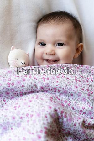 portrait of happy baby girl lying