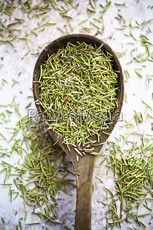 rosemary on wooden bowl
