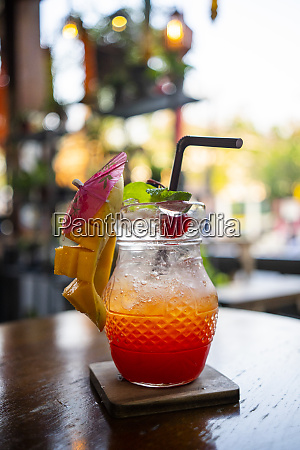 cocktail with mango strawberry and mint