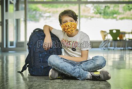 boy sitting on the floor in