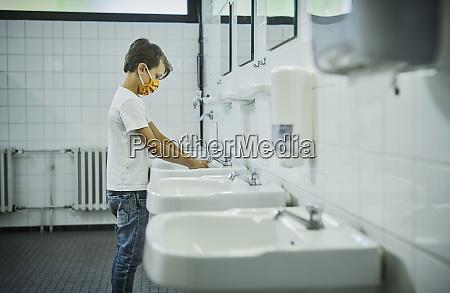 boy wearing mask on school toilet