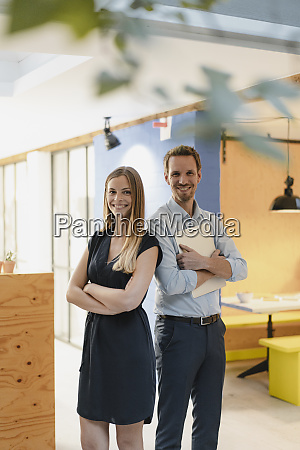 businessman and businesswoman standing in modern