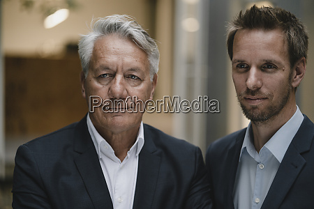 portrait of two businessmen looking at