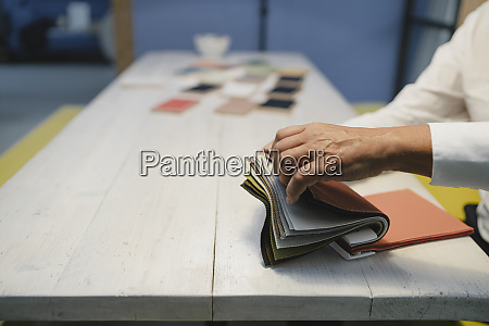 hand of architect choosing from cloth