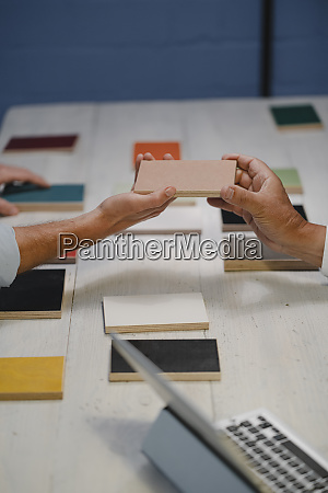 hands of architects choosing colour samples