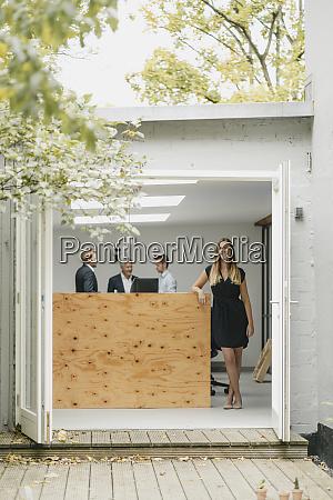 businesswoman standing in open office door
