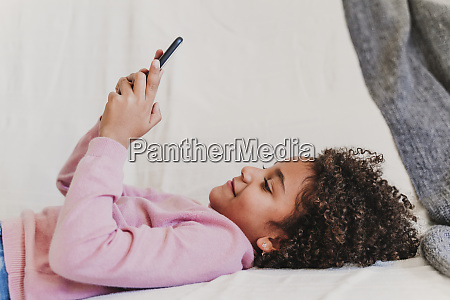 portrait of happy little girl lying