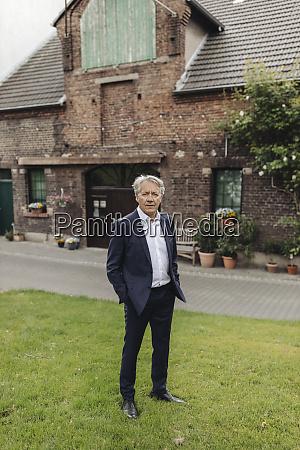 portrait of a senior businessman standing