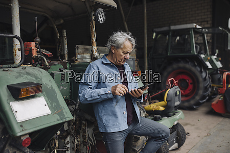 senior man using tablet on a