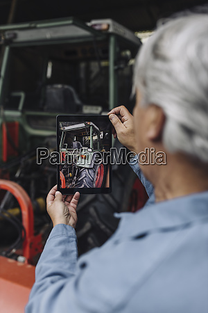 senior man taking picture of a