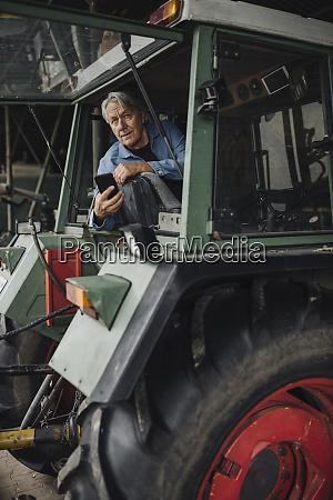 senior man holding smartphone on a