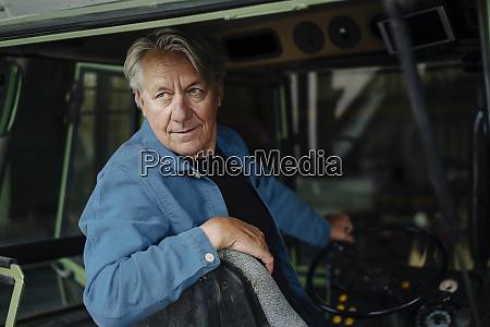 portrait of a senior man driving