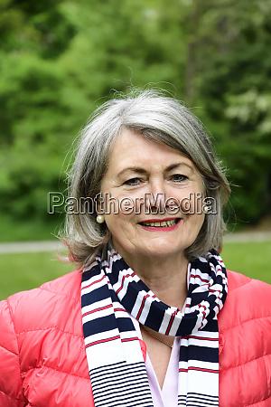 contented senior woman wearing muffler and