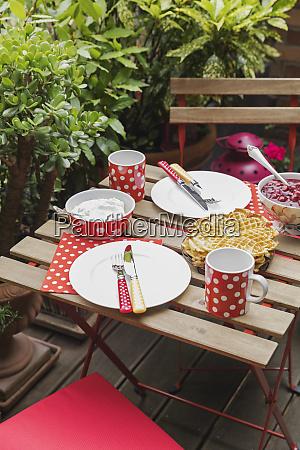 homemade waffles on small table set