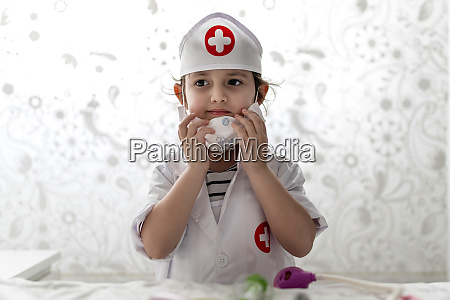 girl in a doctors costume wearing