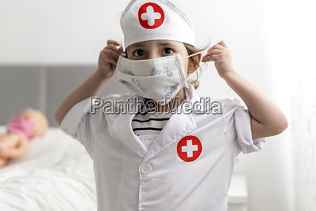 girl in doctors costume caring of