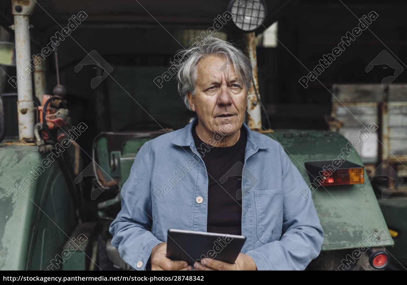 senior, man, holding, tablet, on, a - 28748342