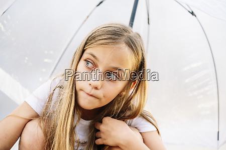 cute blond girl looking away