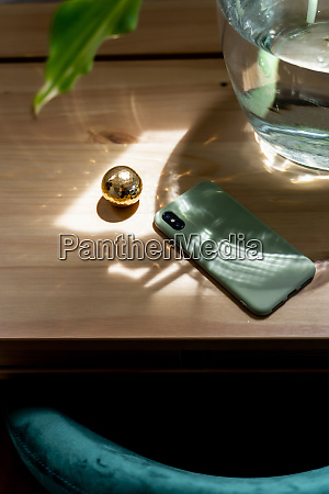 mobile phone by golden ball on