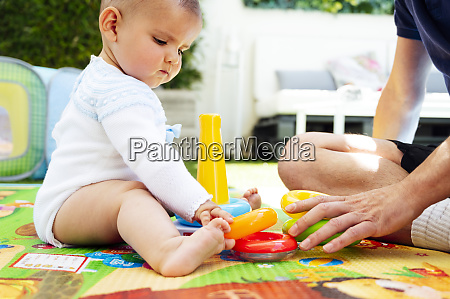 father and cute son playing with