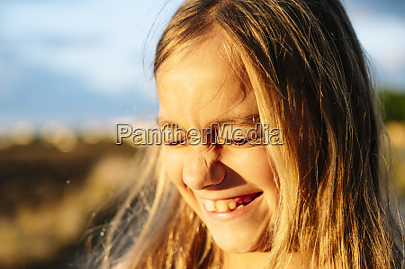 close up of cheerful blond girl