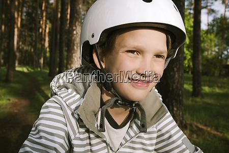 happy boy wearing cycling helmet in