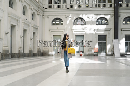 stylish young woman walking on flooring