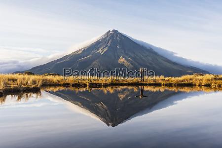 new zealand mounttaranakivolcano reflecting in shiny