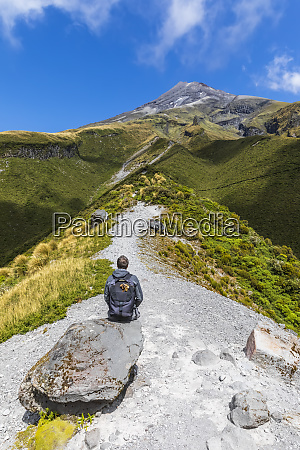 new zealand male hiker admiring surrounding