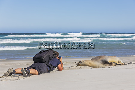 new zealand dunedin male backpacker photographing