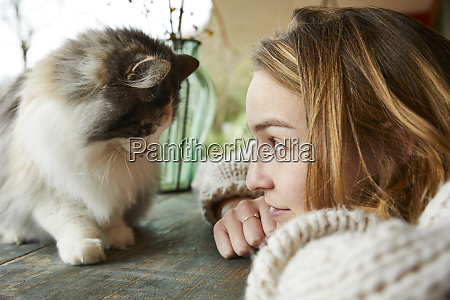 young woman looking at norwegian forest