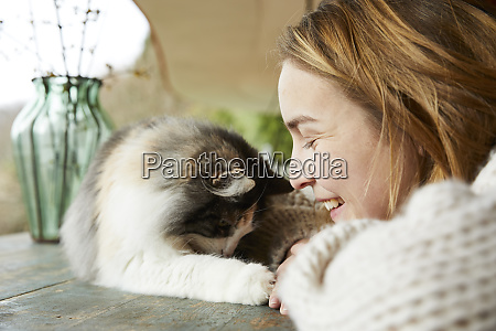 happy woman with norwegian forest cat