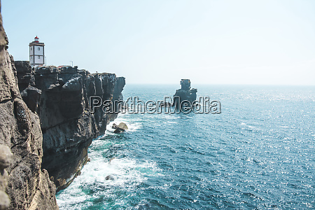 lighthouse at the steep coast peniche