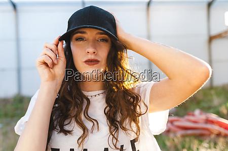 beautiful young woman wearing cap during