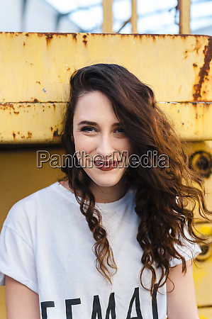 beautiful young woman smiling on metallic