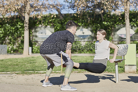 woman during work out with coach