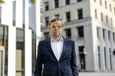 businessman wearing 2020 comedy glasses in